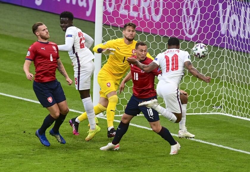 England's Raheem Sterling, right, scores his team's first goal during the Euro 2020 soccer championship group D match between the Czech Republic and England at Wembley stadium, London, Tuesday, June 22, 2021. (Neil Hall/Pool Photo via AP)