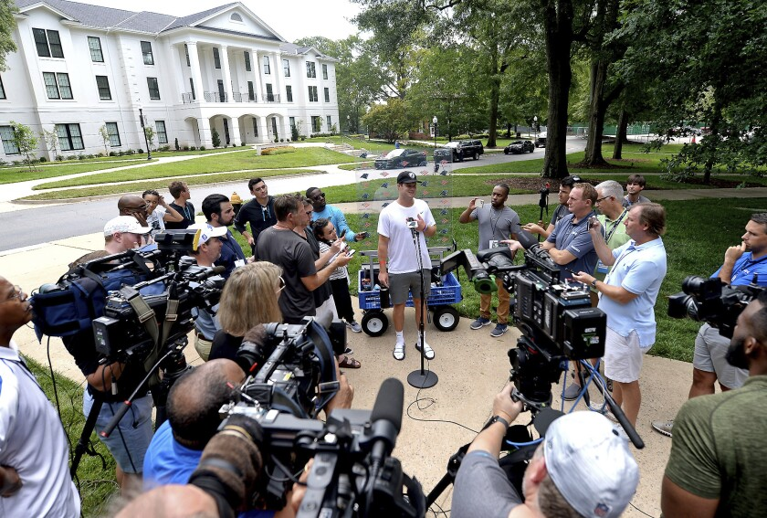 Carolina Panthers quarterback Sam Darnold, center, speaks to the media at NFL football training camp, Tuesday, July 27, 2021, at Wofford College in Spartanburg, S.C. (Jeff Siner/The Charlotte Observer via AP)