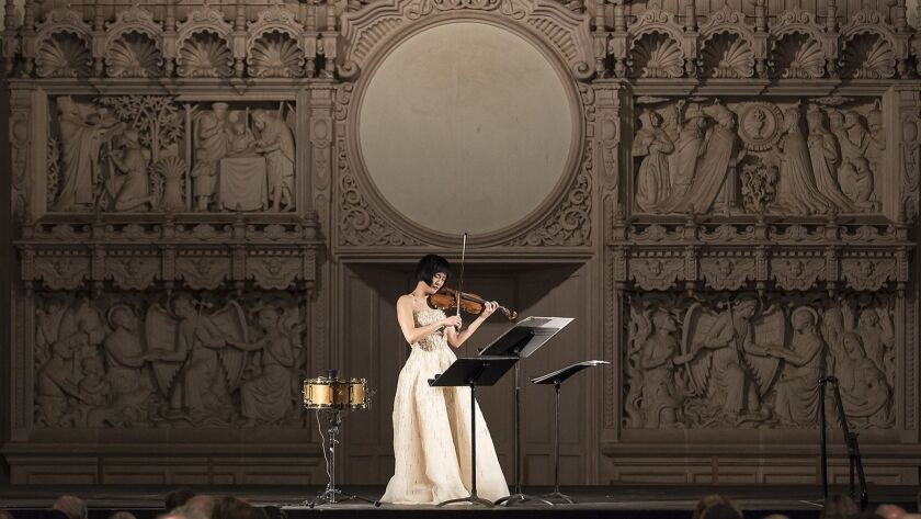 "Violinist Jennifer Koh performs selections from ""Shared Madness"" on Friday at St. Anthony Chapel in Santa Barbara."