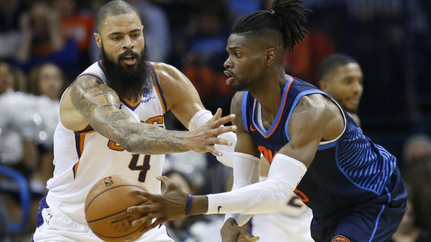 Suns center Tyson Chandler defends Thunder forward Nerlens Noel during a game Oct. 28.