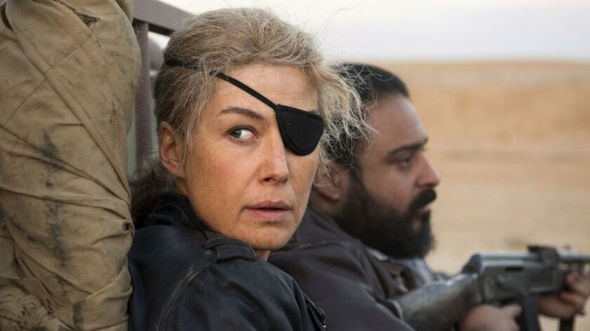 """This image released by Aviron shows Rosamund Pike in a scene from """"A Private War."""" On Thursday, Dec."""