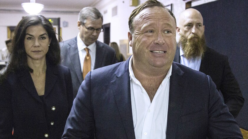 "FILE - In this April 17, 2017, file photo, ""Infowars"" host Alex Jones arrives at the Travis County C"