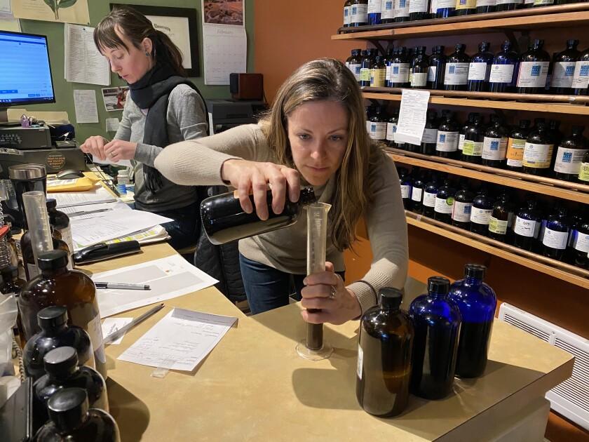 Katya Difani prepares tincture at Herban Wellness, Kirkland, Wash.