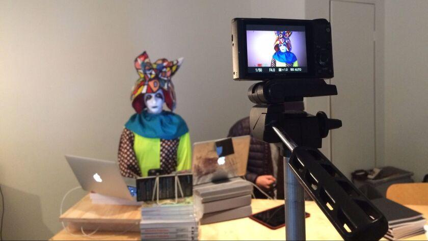 Artist Rachel Mason dressed up as her character FutureClown, preparing to lip-sync Trump's speech at LACE.