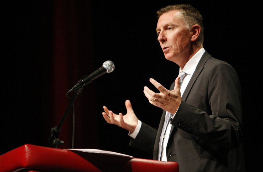 Los Angeles Unified School District Superintendent Dr. John Deasy makes his annual address to district administrators at Hollywood High School in August 2013. According to district officials, Deasy will resign from the post in February.