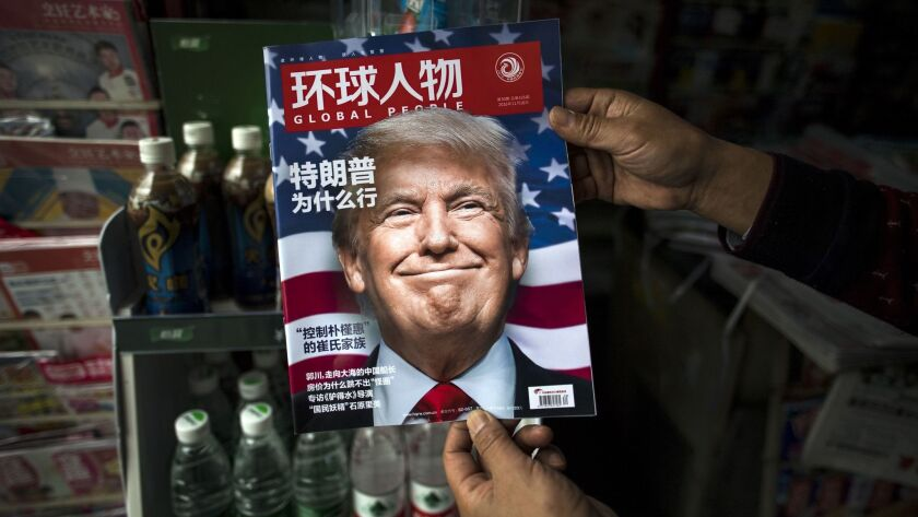 "President-elect Donald Trump appears on the cover of the Chinese magazine Global People, which features an article that translates to ""Why did Trump win,"" at a newsstand in Shanghai."