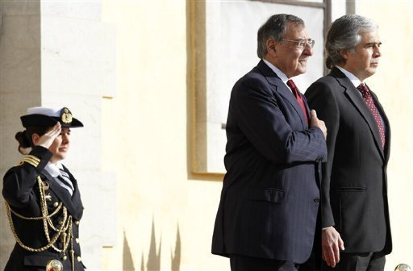 U.S. Defense Secretary Leon Panetta, second right, and Portugal's Defense Minister Jose Pedro Aguiar-Branco listen to the national anthems at the Sao Juliao fort in Oeiras, near Lisbon, Tuesday, Jan. 15, 2013. This is the first stop of a European trip that is expected to be Panetta's last overseas trip as secretary. (AP Photo/Francisco Seco)