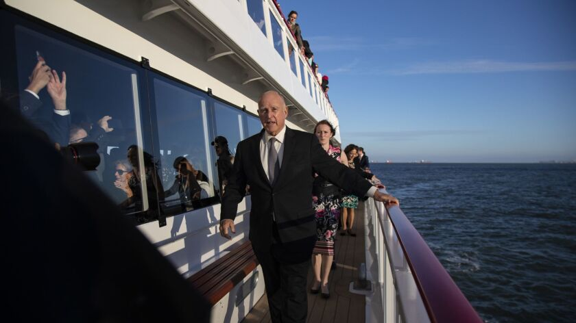 Gov. Jerry Brown makes his way to the bow of a hybrid ferry cruising the San Francisco Bay at the end of the day's events during the Global Climate Action Summit on Thursday.