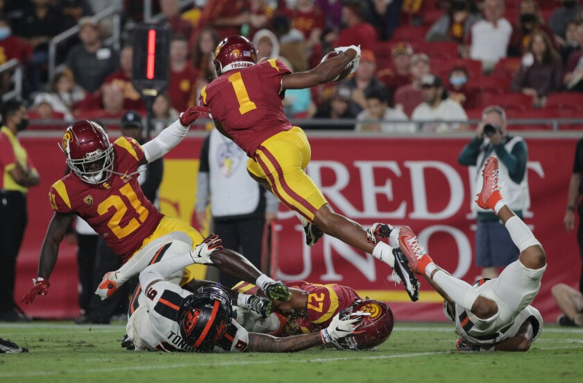 USC's Gary Bryant Jr. leaps over his Quincy Jountti.