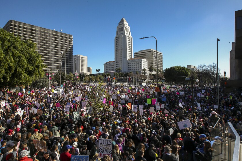 Women's March Los Angeles fills the streets near City Hall and Grand Park on Saturday.