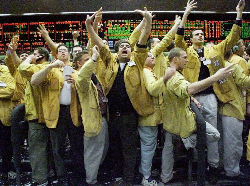 FILE - In this Dec. 21, 1999 file photo, Nicholas Torres, center, shouts an order in the eurodollar pit at the Chicago Mercantile Exchange just as the Fedeal Reserve was announcing that there would be no change in interest rates. Floor trading has shrunk to a fraction of its volume from two decades