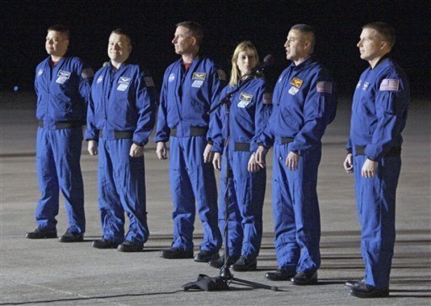 Astronauts of space shuttle Endeavour, from left, mission specialist's Bob Behnken, Nicholas Patrick, Steve Robinson, Kay Hire, commander George Zamka and pilot Terry Virts, arrive at the Kennedy Space Center in Cape Canaveral, Fla., Tuesday, Feb. 2, 2010, to prepare for their upcoming launch. Endeavour is scheduled for an early morning liftoff on Feb. 7 on a mission to the International Space Station. (AP Photo/John Raoux)