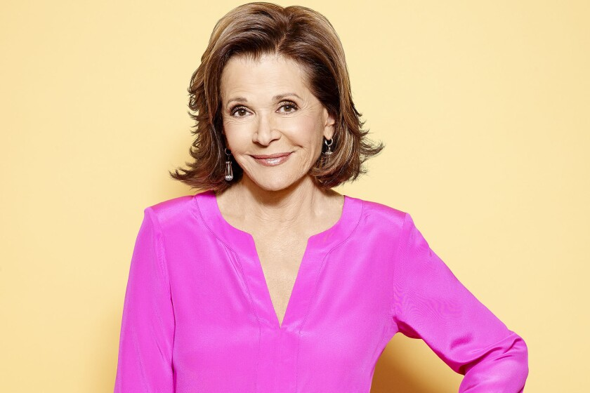 A portrait of Jessica Walter in a hot pink blouse.