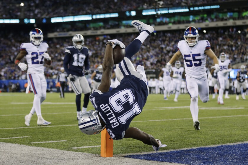 Cowboys receiver Michael Gallup flips over the goal line for a touchdown against the Giants during the fourth quarter of a game at MetLife Stadium.