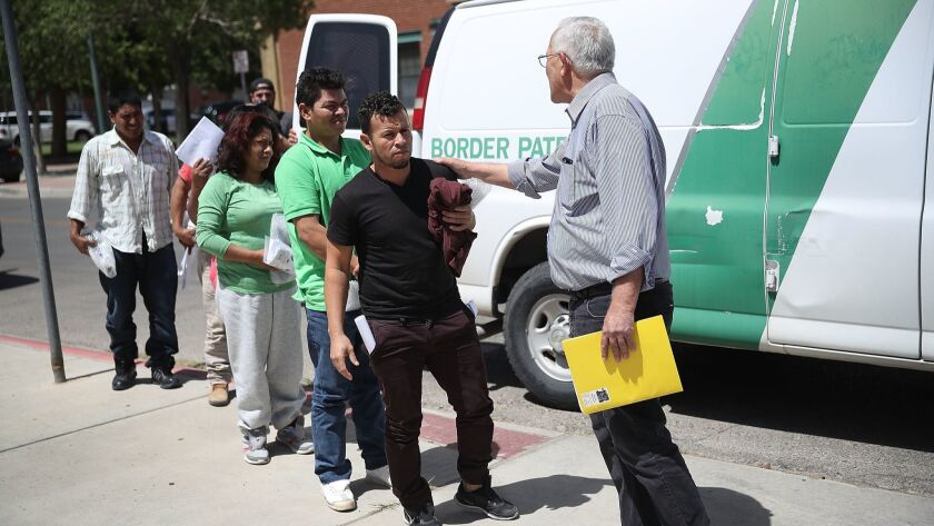 Ruben Garcia, right, director of the Annunciation House shelter, greets migrant parents, all of whom were separated from their children by U.S Customs and Border Patrol, as they arrive at his facility in El Paso on June. 24, 2018.