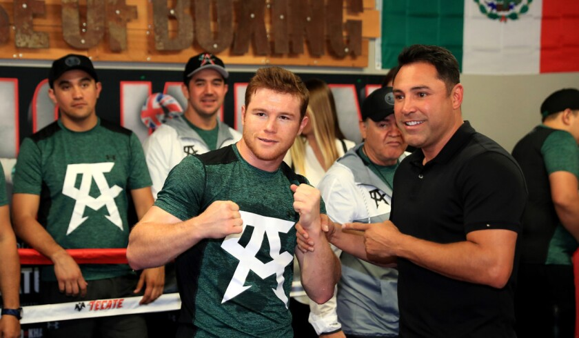 "Saul ""Canelo"" Alvarez, left, poses with Oscar De La Hoya during a media workout."