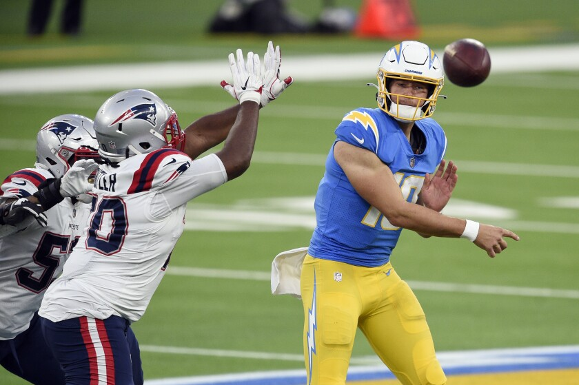 Chargers quarterback Justin Herbert throws against the New England Patriots on Dec. 6, 2020.