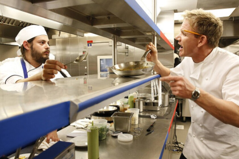 Chef Gordon Ramsay, right, berates James in a restaurant takeover.