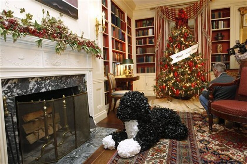 "Bo, the Obama family dog, made from plastic garbage bags, is seen in the Library of the White House in Washington, Wednesday, Nov. 30, 2011, as the Christmas holiday decorations, whose theme is ""Shine, Give, Share"" were previewed. (AP Photo/Charles Dharapak)"