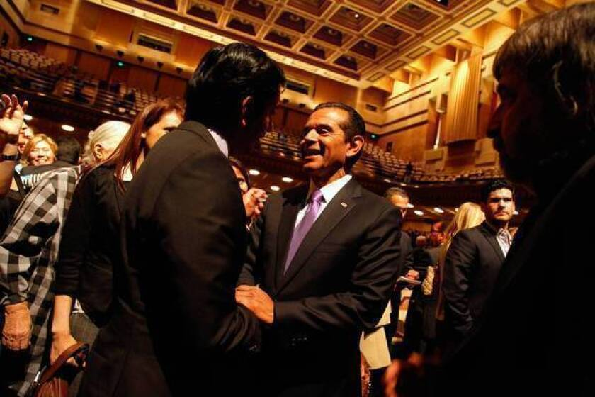 """Mayor Antonio Villaraigosa shakes hands with supporters after his final State of the City address. """"L.A. is on the move,"""" he said."""