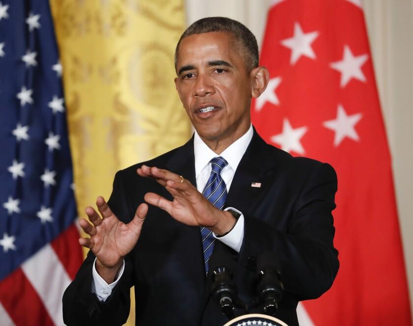 El presidente Barack Obama responde preguntas durante una conferencia de prensa con el primer ministro de Singapur, Lee Hsien Loong, en el Salon Este de la Casa Blanca en Washington DC, el martes 2 de agosto de 2016. (AP Foto/Pablo Martínez Monsiváis)