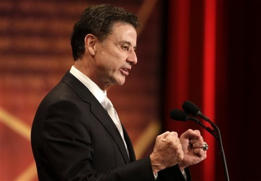 Inductee Rick Pitino speaks during the enshrinement ceremony for the 2013 class of the Naismith Memorial Basketball Hall of Fame at Symphony Hall in Springfield, Mass., Sunday, Sept. 8, 2013. (AP Photo/Steven Senne)