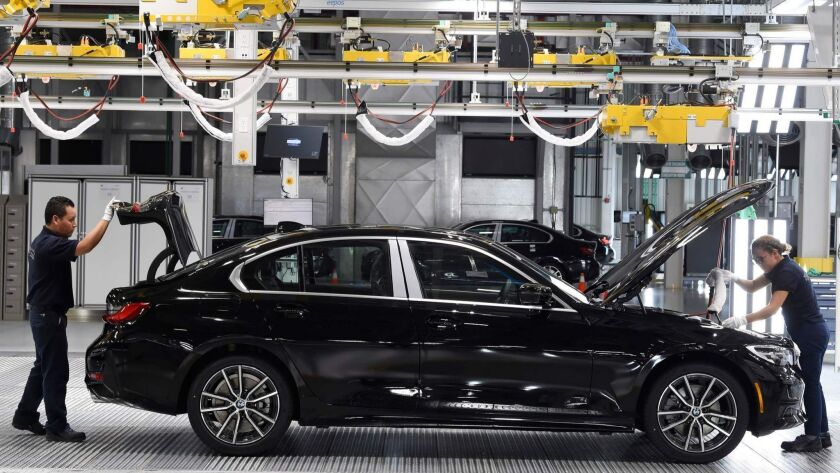 BMW employees work on a 3 Series sedan at the company's new factory in San Luis Potosi, Mexico.