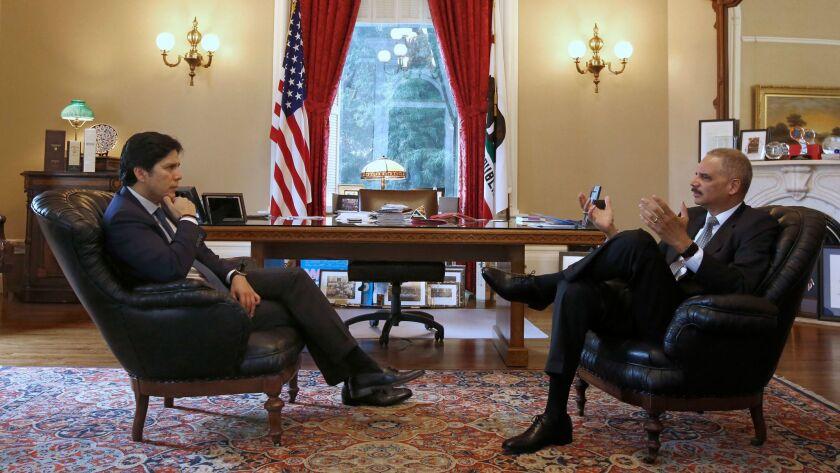 Senate President Kevin de Leon (D-Los Angeles), left, meets with former U.S. Atty. Gen. Eric Holder in Sacramento.