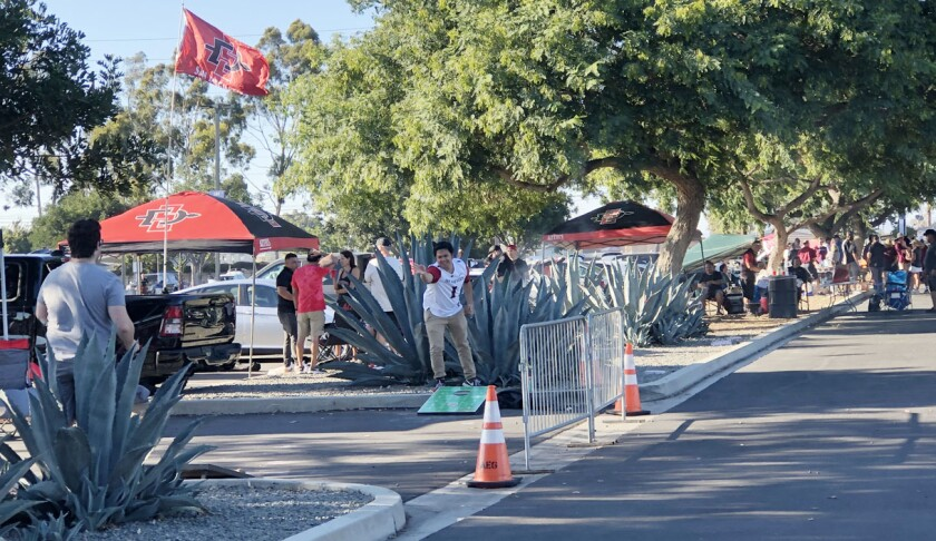 Games of corn hole were among the activities for Aztecs fans tailgating at Dignity Health Sports Park.