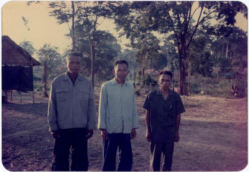 Ao An, right, in a 1980 photo in Veal Veng, Cambodia, after the fall of the Khmer Rouge.