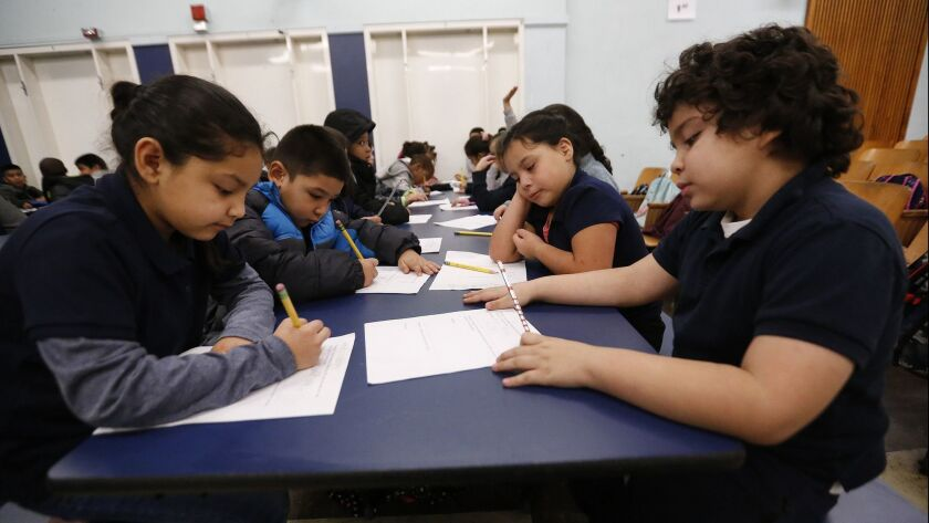 First grade students work together in the auditorium at 99th Street Elementary School in South Los Angeles on the 4th day of the LA teachers' strike on Jan. 17.