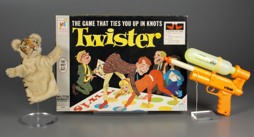 In this Sept. 24, 2015 photo provided by The Strong's National Toy Hall of Fame in Rochester, N.Y., a puppet, the game of Twister and a Super Soaker are shown in a studio photo. On Thursday, Nov. 5, 2015, The Strong's National Toy Hall of Fame announced that they have been chosen from a field of 12