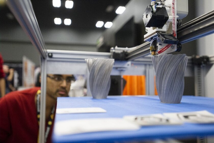 An attendee looks at a Gigabot 3-D printer at the South by Southwest Interactive Festival in Austin, Texas, last month.