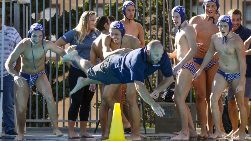 LA JOLLA, November 10, 2018 | Steele Canyon boys water polo coach Dan Way dives into the pool as he