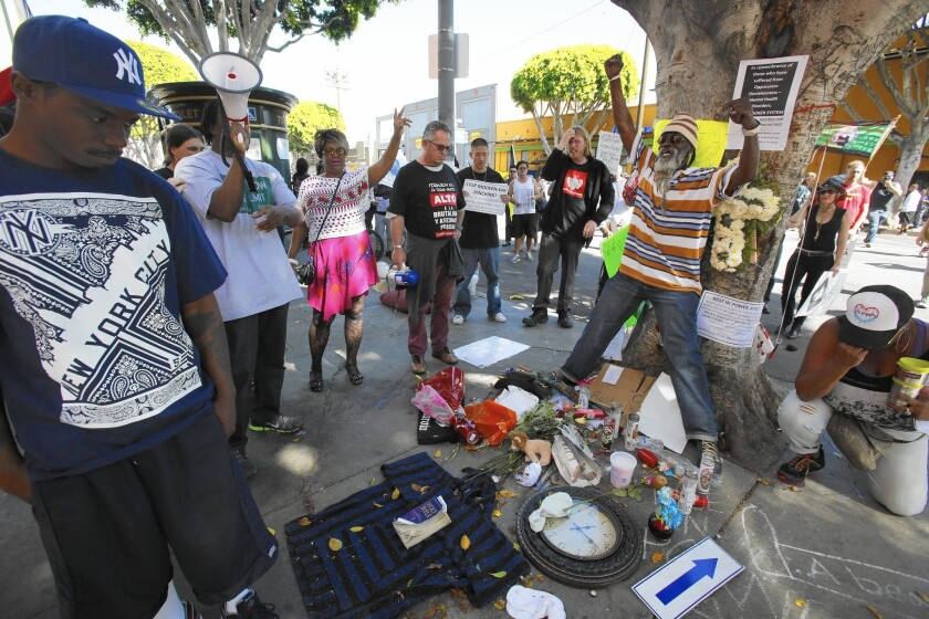 Dozens protest LAPD shooting of homeless man
