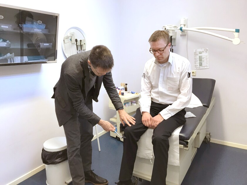Dr. Jako Burgers examines Erik Eikelenstam at his offices in Gorinchem, a small city south of Amsterdam.