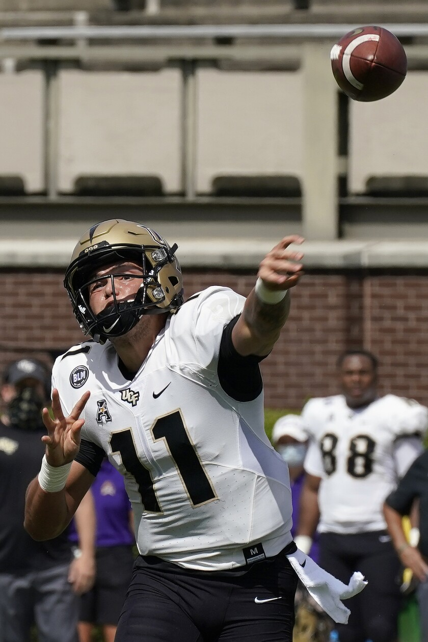 Central Florida quarterback Dillon Gabriel (11) passes against East Carolina during the first half of an NCAA college football game in Greenville, N.C., Saturday, Sept. 26, 2020. (AP Photo/Gerry Broome)