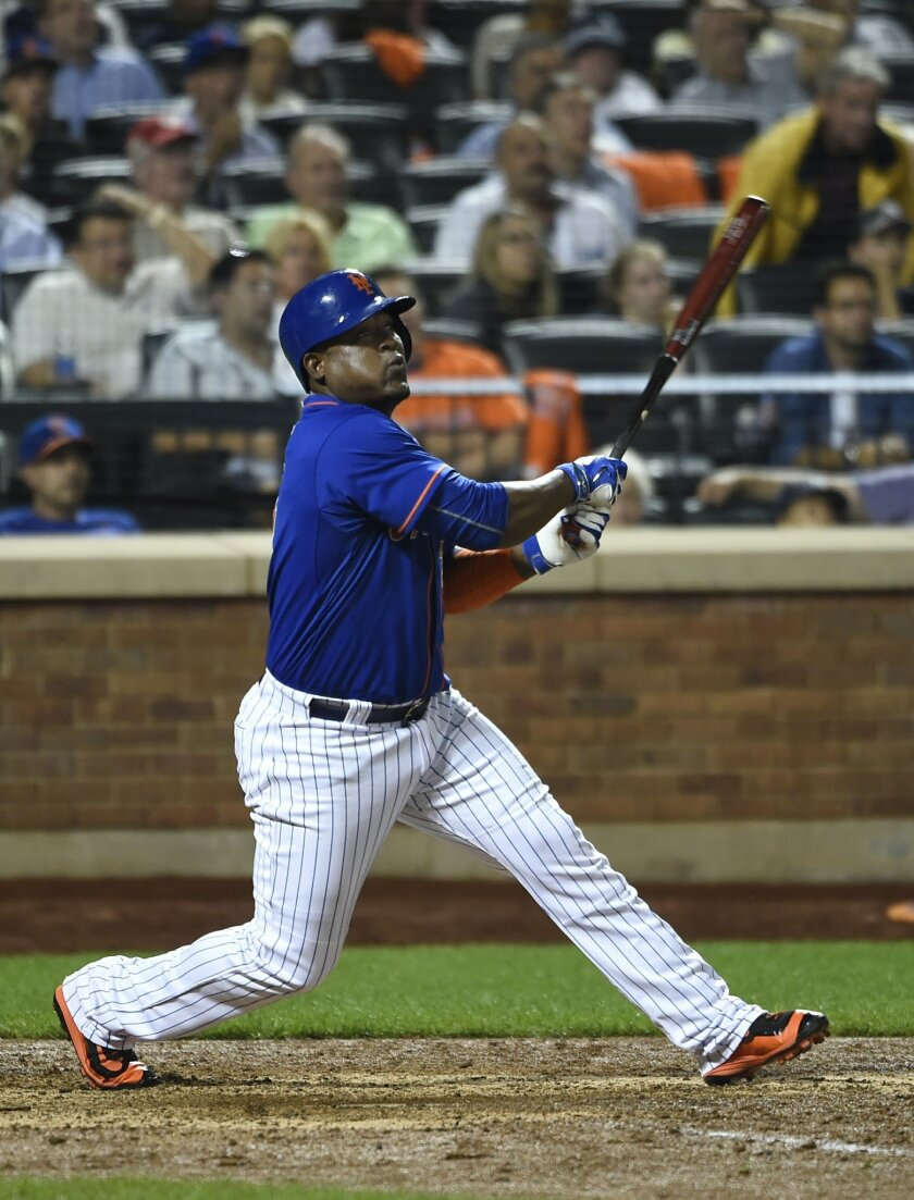 FILE - In this Sept. 18, 2015, file photo, New York Mets' Juan Uribe watches his two-run home run off of New York Yankees relief pitcher Chasen Shreve in the seventh inning of a baseball game, in New York. The Cleveland Indians have agreed to a one-year, $5 million contract with veteran infielder J