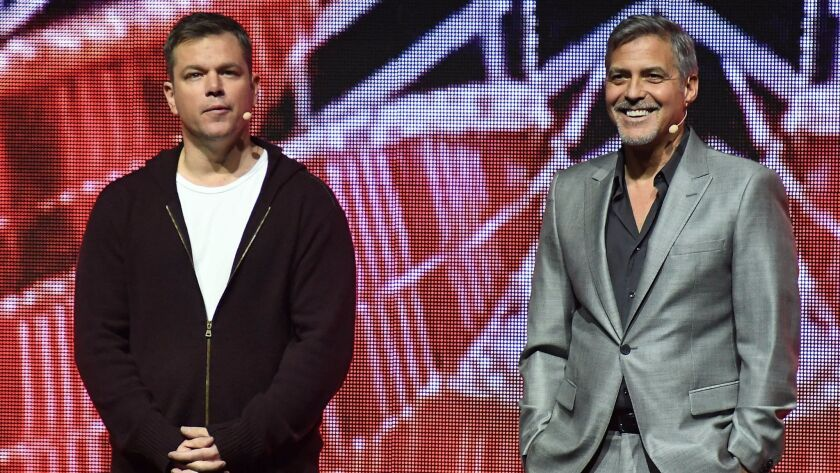 Matt Damon and George Clooney onstage at Paramount Pictures' CinemaCon 2017 presentation.