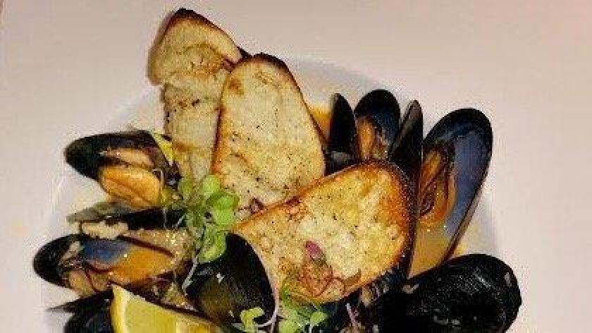 Mussels at Harney Sushi have an incredible miso broth infused with kimchi, garlic, ginger and citrus. Extra bread is recommended. (/ Amy T. Granite)