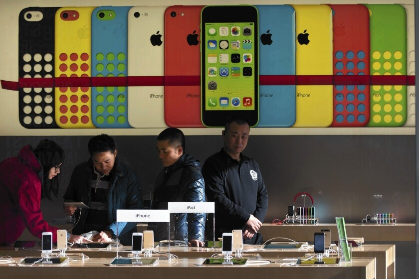 The messages that Apple is forbidden from engraving on iPads for customers in China illustrate how the nation's censorship efforts extend deep into the mundane nooks and crannies of everyday life and commerce. Above, customers check out iPads at an Apple store in Beijing.