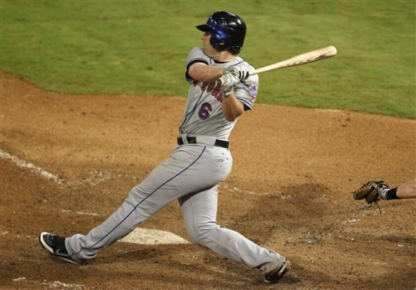 New York Mets' Nick Evans (6) follows through on a RBI single to score Angel Pagan in the eighth inning during a baseball game against the Florida Marlins in Miami, Tuesday, Sept. 6, 2011. (AP Photo/Lynne Sladky)