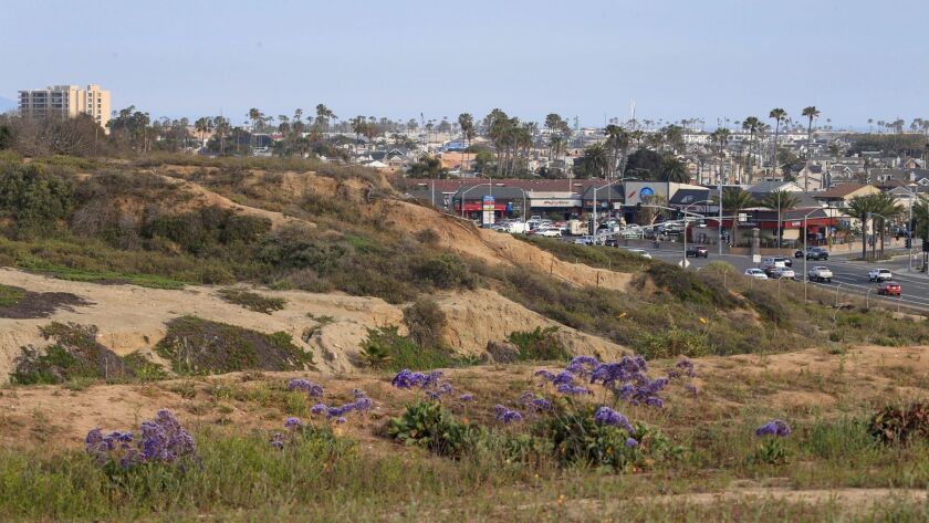 The bluffs of the 401-acre Banning Ranch property rise above Pacific Coast Highway in Newport Beach. Developers have been seeking to build homes, a shopping complex and a resort hotel on the site.