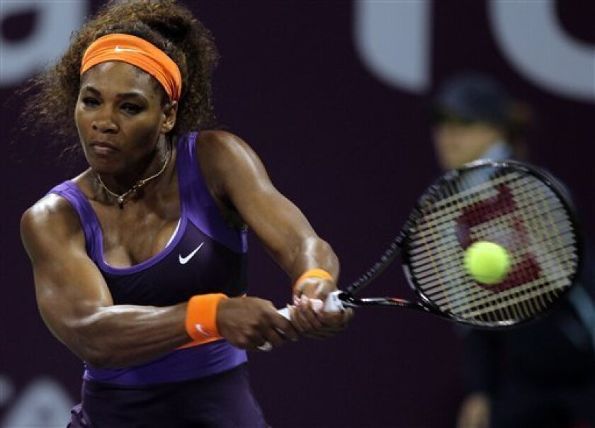 Serena Williams of the U.S. returns the ball during her match against Daria Gavrilova of Russia on the second day of the WTA Qatar Ladies Open in Doha, Qatar, Tuesday, Feb. 12, 2013. (AP Photo/Osama Faisal)