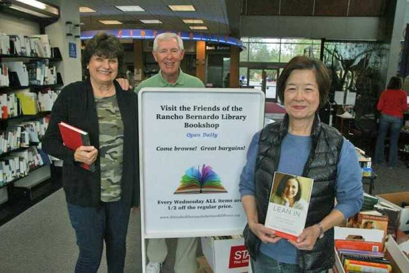 """The Friends of the Rancho Bernardo Library are preparing for their Summer Book Sale, which includes CDs and DVDs. The theme is """"Pack your Bags for Summer Vacation…with books, of course."""" The sale is set for 9:30 a.m. to 3:30 p.m. June 8 at the library, 17110 Bernardo Center Drive. A bag full of books is $5, or $3 for members of the Friends of the Rancho Bernardo Library. Customers are encouraged to bring bags or comparably sized boxes. RB Friends volunteers (from left) include Judy Brucker, Dick Luehring and Shou Wei Lam. Proceeds go toward library programs and books. Visit friendsoftherblibrary.org."""