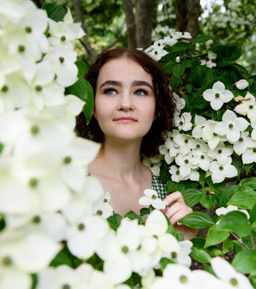Millicent Simmonds amid boughs of flowers at the Phipps Conservatory in Pittsburgh.