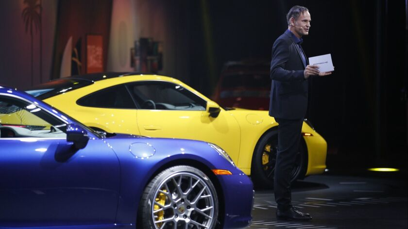 Porsche CEO Oliver Blume introduces 2020 Porsche 911 models during a news conference at the L.A. Auto Show on Wednesday.
