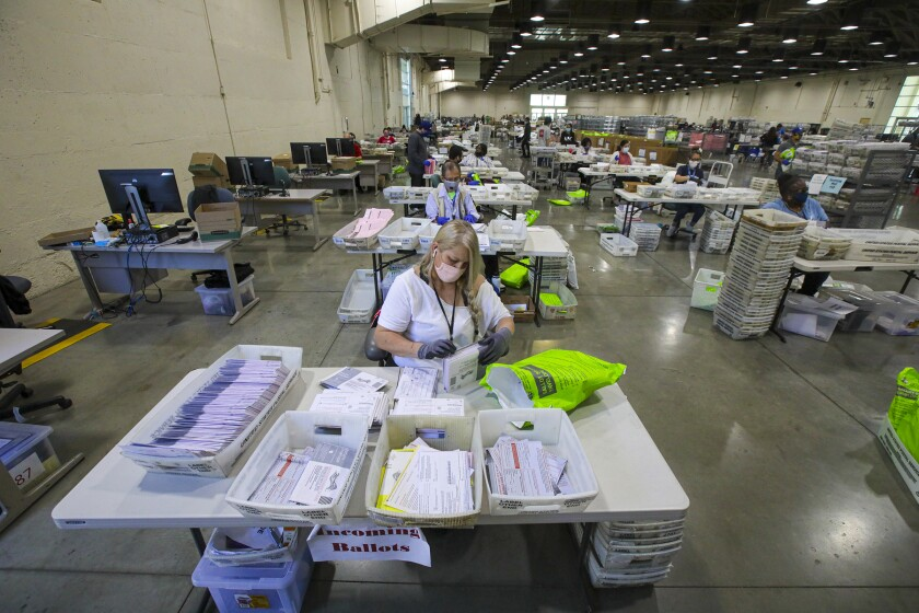 Patricia Fitzgerald sorts  mail ballots at L.A.  County Registrar facility in Pomona.