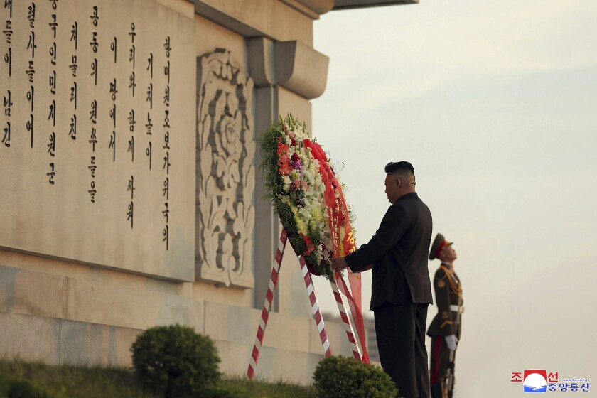 """In this photo provided by the North Korean government, North Korean leader Kim Jong Un lays a wreath at Friendship Tower in Pyongyang, North Korea, Wednesday, July 28, 2021, a day after North Korea marked the 68th anniversary of the end of the Korean War. Independent journalists were not given access to cover the event depicted in this image distributed by the North Korean government. The content of this image is as provided and cannot be independently verified. Korean language watermark on image as provided by source reads: """"KCNA"""" which is the abbreviation for Korean Central News Agency. (Korean Central News Agency/Korea News Service via AP)"""