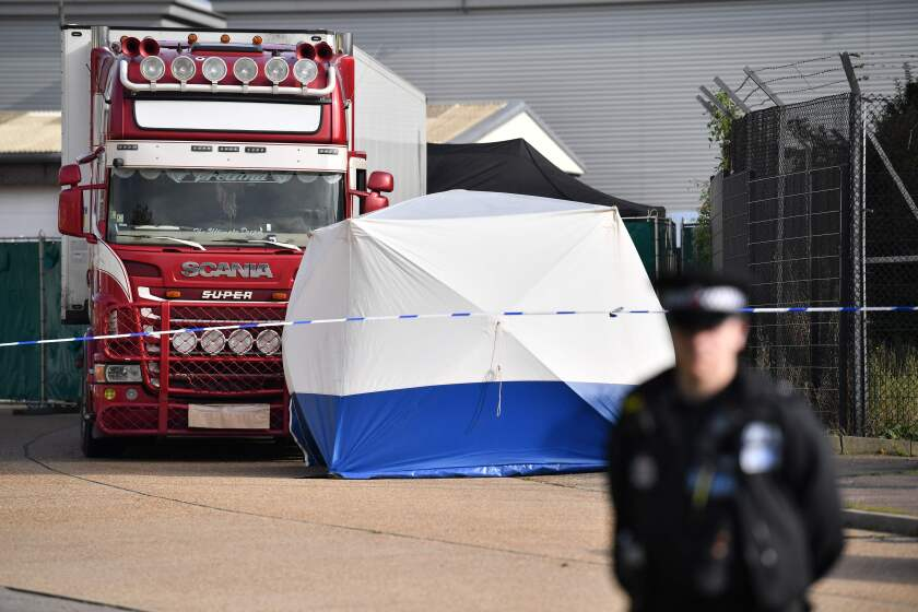 A police officer secures the scene where a truck containing 39  bodies was discovered at Waterglade Industrial Park in Grays, east of London, on Wednesday.